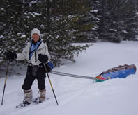 Cathy Susan of Ann Arbor, Michigan pulls her sledge across Agler County's Long Lake during a 6-day, January '05 winter-camping trip south of the Pictured Rocks National Lakeshore (Photo courtesy of Mary Powell of Flint, Michigan)