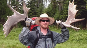 Chris Ozminski with 2 moose sheds he found on the July '05 Canadian Expedition to Grindstone Point, deep in the heart of Lake Superior Provincial Park