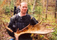 Chris Ozminski holding moose shovel
